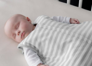 Baby sleeping in cot - Libby & Co. Antenatal in home care Auckland